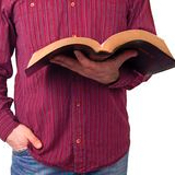 cropped-man-holding-bible-isolated-white-29867007